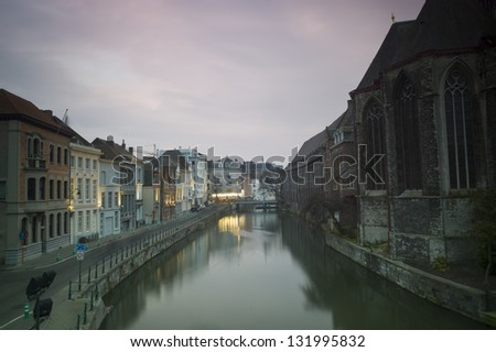 GHENT, BELGIUM - NOV 27: Night view of Ghent, Belgium, on November 27, 2012, is the capital  the East Flanders province. The Graslei is one of the most scenic places in Ghent's old city centre.