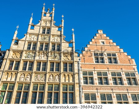 Ghent city scenes in Belgium, residential buildings, church, attractive and beautiful scenes, under blue sky - stock photo