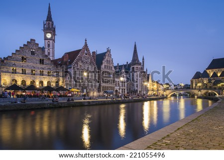 GHENT, FLANDERS/BELGIUM SEPTEMBER 03. Tourists and locals enjoy a summers night in bars and restaurants on Graslei in Ghent - stock photo