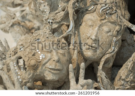 Ghost face from hell, Conceptual sculpture decorations in Rongkhun Temple Chiangrai, Thailand. - stock photo