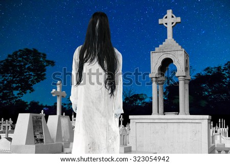 Ghost Girl Horror with Graveyard in night sky  - stock photo