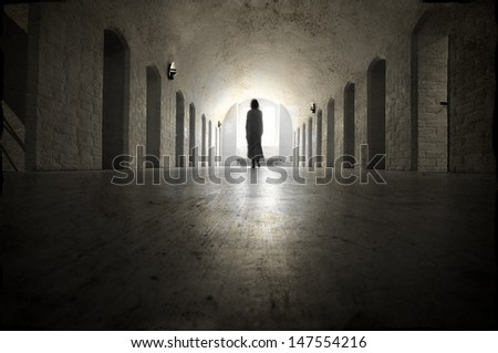 Ghost in an old medieval lunatic asylum. - stock photo