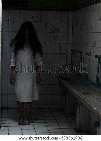 Ghost in bathroom/Ghost on halloween day, Dark tone - stock photo
