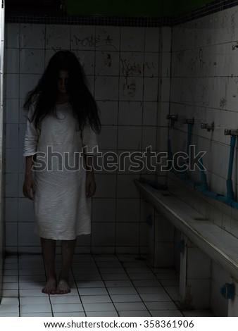Ghost in bathroom/Ghost on halloween day, Dark tone - stock photo