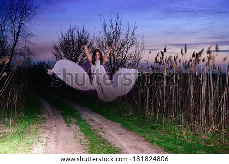 Ghost on a rural road. Evening - stock photo
