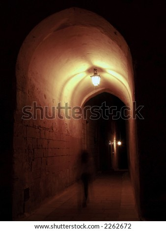 Ghost walking through medieval archway - stock photo