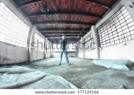 ghost worker in abandoned factory - stock photo