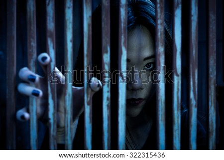 ghosts holding Fence , Halloween image. - stock photo