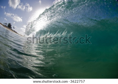 giant breaking wave in clear hawaii waters - stock photo
