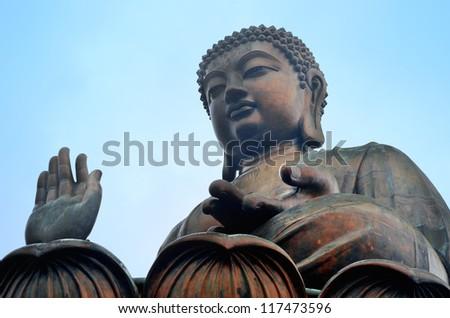 Giant bronze Buddha statue in Hong Kong. - stock photo
