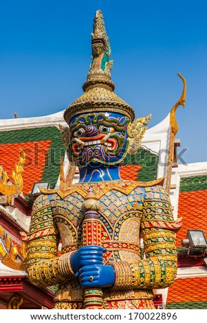 Giant Buddha in Wat Phra Kaeo, Temple of the Emerald Buddha and the home of the Thai King. Wat Phra Kaeo is one of Bangkok's most famous tourist sites and it was built in 1782 at Bangkok, Thailand. - stock photo