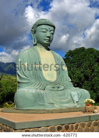 Giant Budha Statue against a Beautiful Sky - stock photo