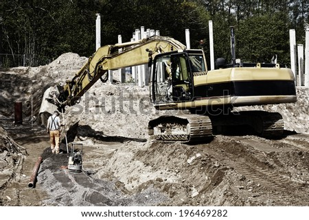 giant bulldozer, digger in action, road works and construction industry - stock photo