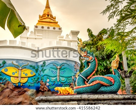 Giant Chinese dragon at Wat Pho public temple, Bangkok, Thailand. Wat Pho known also as the Temple of the Reclining Buddha. - stock photo