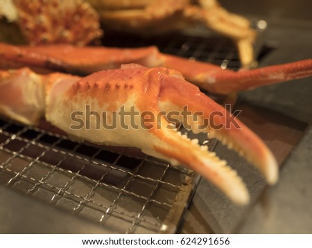 giant claw crab on mesh grill