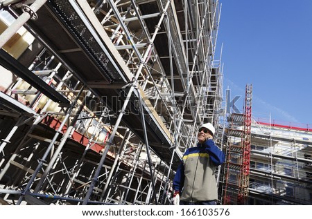 giant construction industry, scaffolding and workers - stock photo