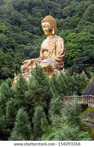 Giant copper buddha statue, shot at Jeng De temple, Puli town, Taiwan, Asia. - stock photo