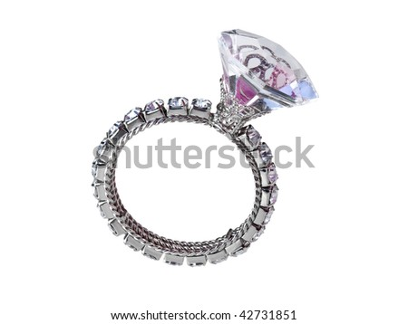 Giant diamond ring falling - stock photo