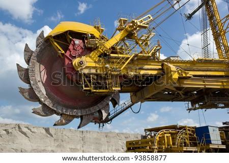 Giant excavator in open-cast coal mine - stock photo