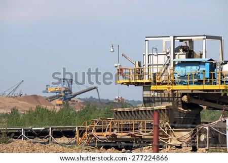 giant excavator working on open coal mine - stock photo