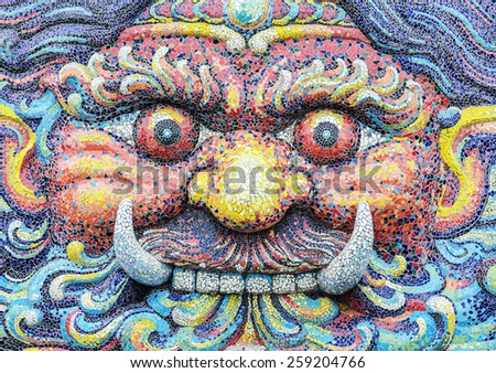 Giant face in temple thailand This is the art page giant temple in Thailand. It does not include any symbol, logo, trademark or copyright. - stock photo