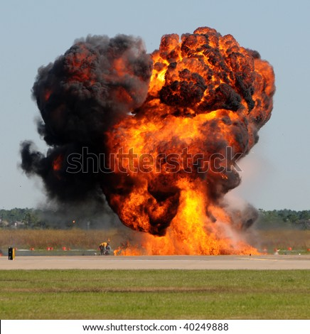 Giant fireball with smoke and flames outdoors - stock photo