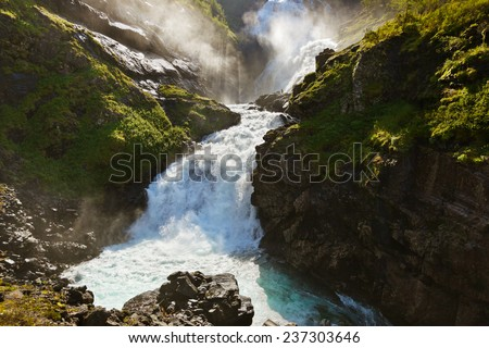 Giant Kjosfossen waterfall in Flam - Norway - nature and travel background - stock photo