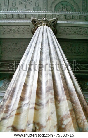 Giant Marble pillar reaching up to the highly decorated ceiling - stock photo