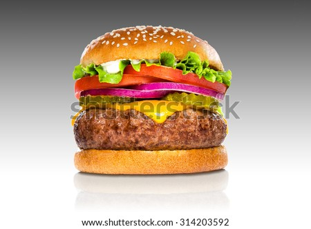 Giant perfect hamburger large massive thick classic american cheeseburger isolated on gradient