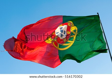 Giant Portuguese flag waving in the wind