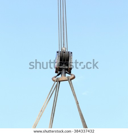 giant pulley with sturdy steel cables to lift heavy loads