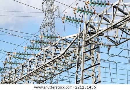 giant pylon of the high voltage electric cables in power station - stock photo