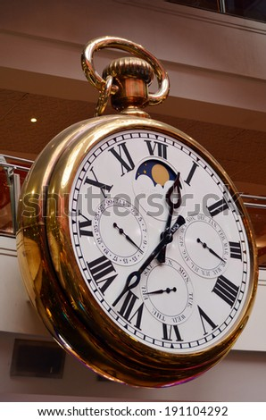 Giant vintage old wall clock. - stock photo