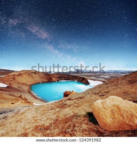 Giant volcano overlooks. Turquoise provides a warm geothermal water. Fantastic Milky Way. Meteor shower. Iceland.