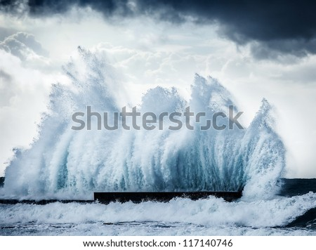 Giant wave splash, beautiful dark dramatic seascape - stock photo