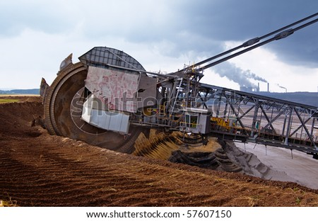 Giant wheel of bucket wheel excavator in a coal open pit in Rhineland, Germany - stock photo