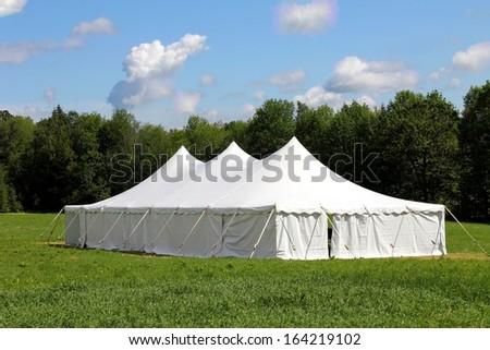giant white wedding or entertainment tent, marquee  - stock photo