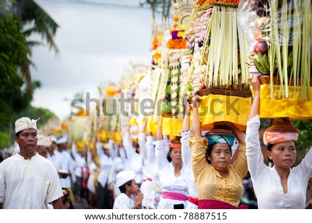 GIANYAR, BALI, INDONESIA- MAY 21:  Unidentified villagers bring gifts to the gods at the Balinese Temple during the Odalan Festival on May 21, 2011 in Gianyar, Bali, Indonesia. - stock photo