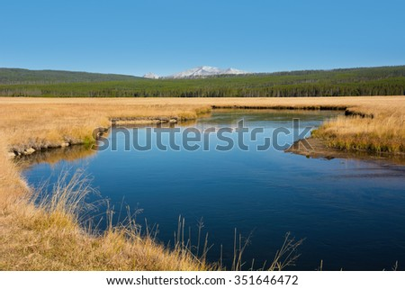 Gibbon River and meadow with Mt. Homes on the horizon. - stock photo