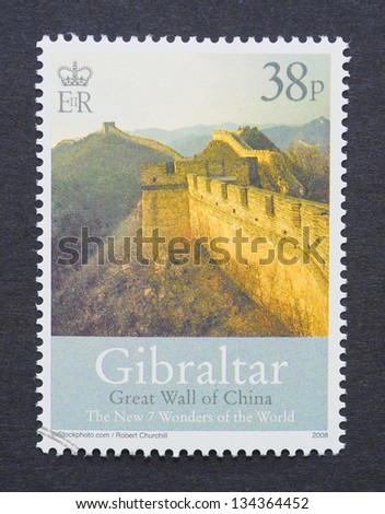 GIBRALTAR - CIRCA 2008: a postage stamp printed in Gibraltar showing an image of Great Wall of China one of the New Seven Wonders of the World, circa 2008. - stock photo