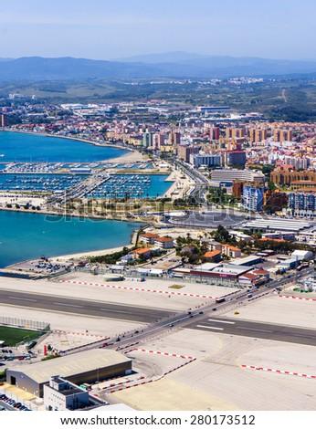 Gibraltar city and airport runway and La Linea de la Concepcion in Spain - stock photo