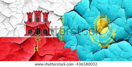 gibraltar flag with Kazakhstan flag on a grunge cracked wall