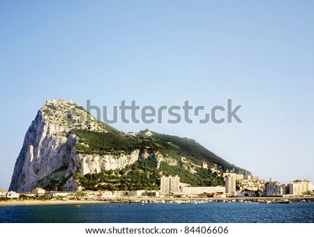 Gibraltar on a sunny day seen from across the bay. - stock photo
