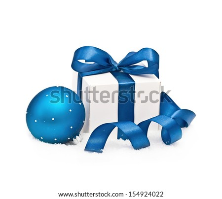 Gift and Christmas sphere on the snow