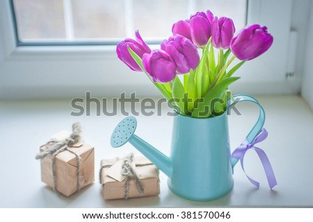Gift and flowers. Spring concept and 8 March - stock photo