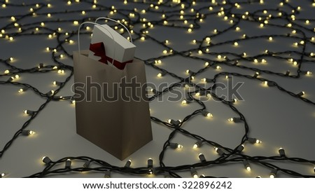 gift bag with box in side surrounded by christmas holiday lights.