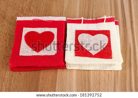 Gift bags on wooden background - stock photo