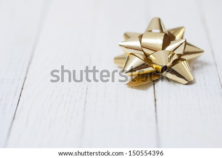 gift bow on white wooden surface