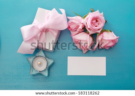 Gift box and blank card with pink roses - stock photo