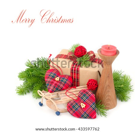 Gift box and decorative Christmas hearts on the sledge on a white background. A Christmas background with space for the text.